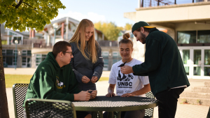 unbc students around a table outside