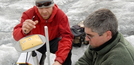 Researchers working on the glacier