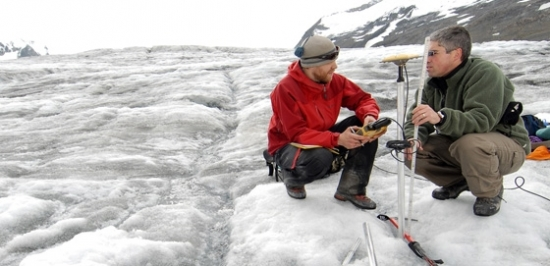 Researchers working on a glacier field