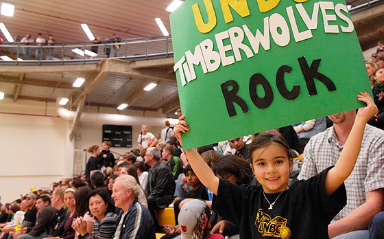 "Girl holding a ""Timberwolves Rock"" sign"