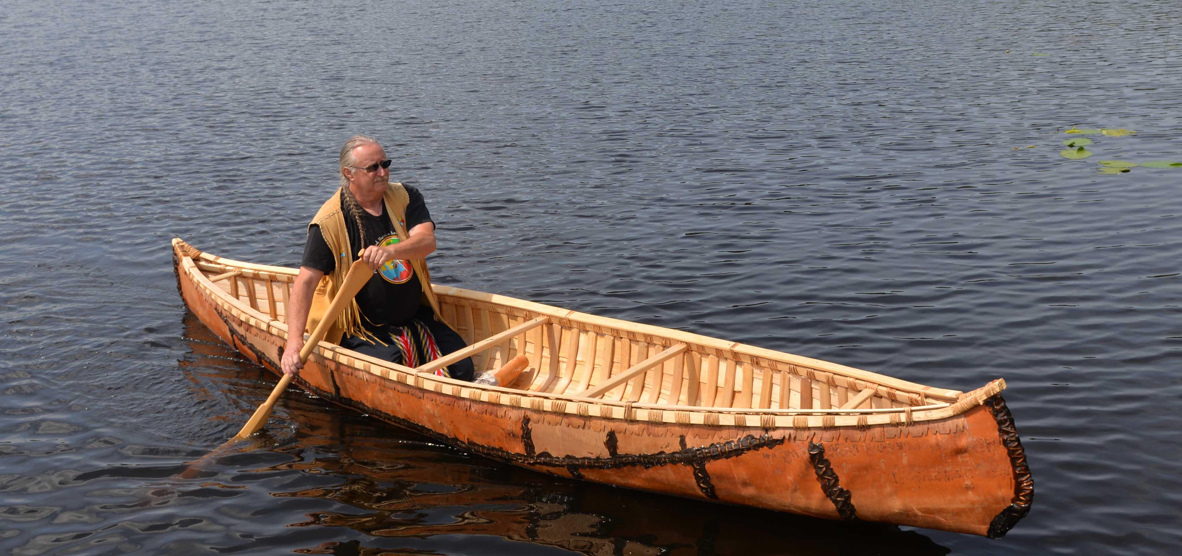 Marcel Labelle paddles the canoe