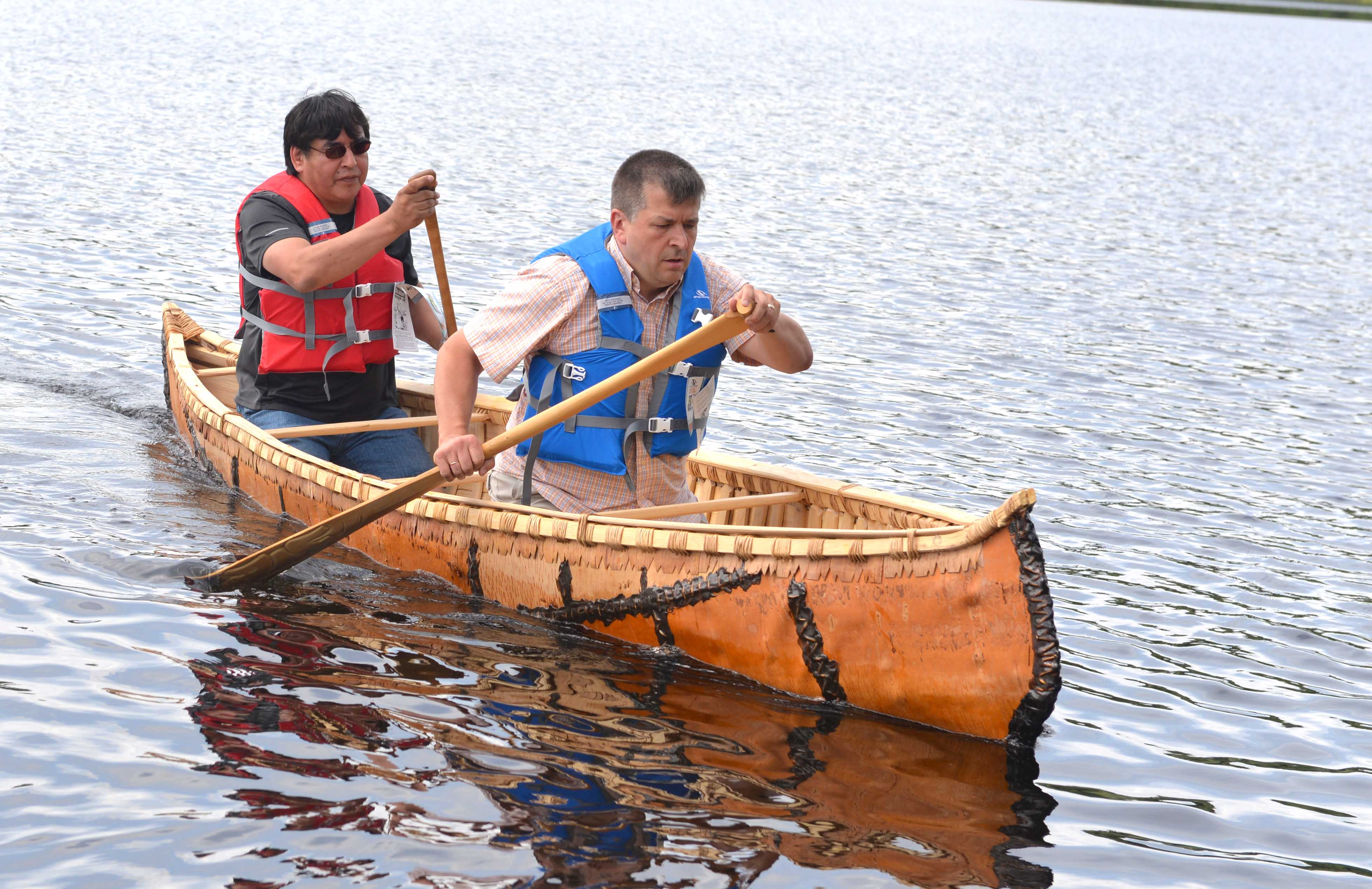 Student Wayne Nipshank and Professor Dr. Michel Bouchard take the canoe for a spin