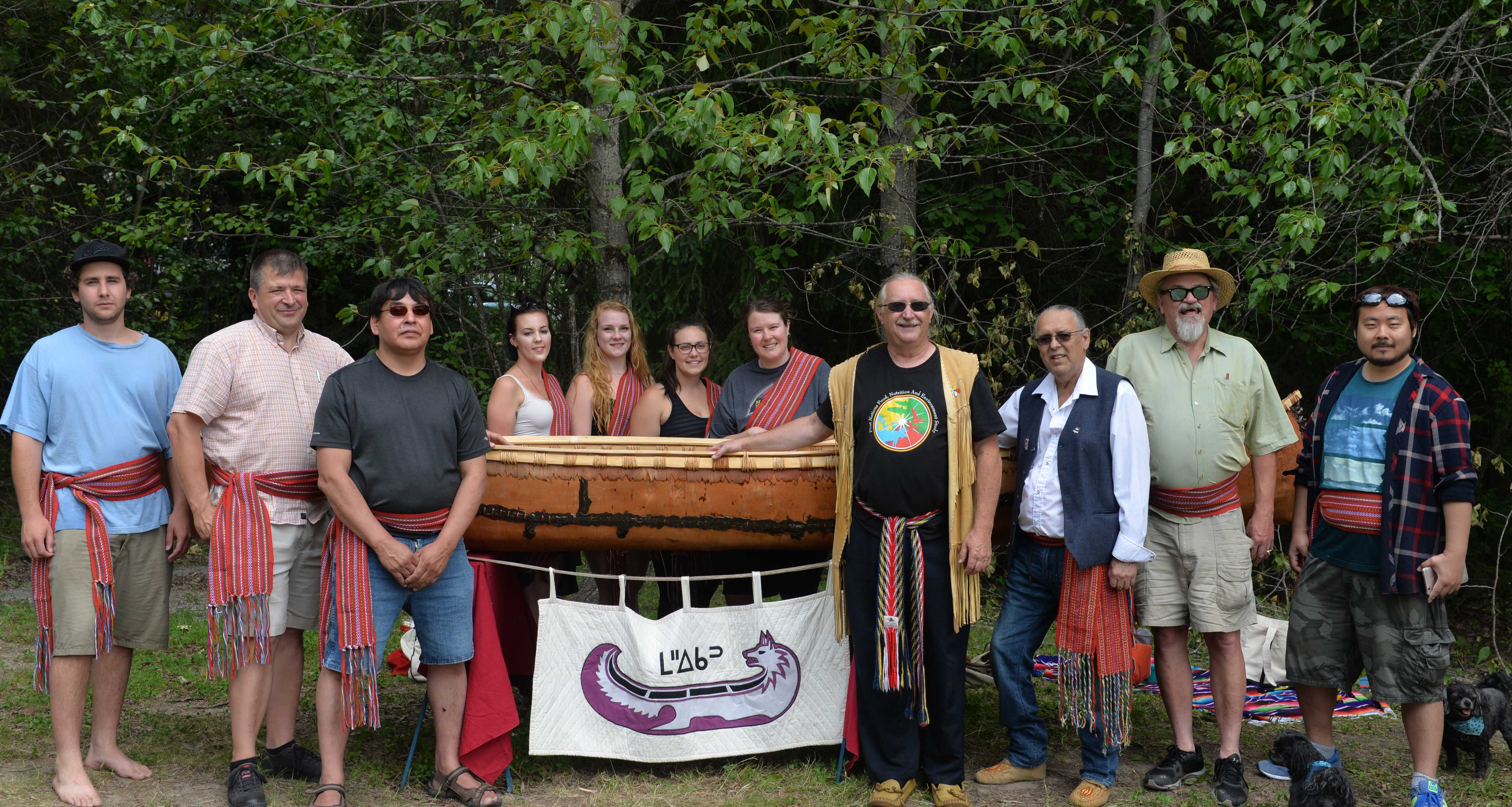 Students and instructors pose with the canoe.