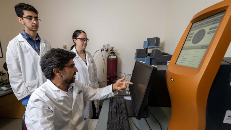 Hossein Kazemian demonstrates equipment in the Northern Analytical Lab Services facility.
