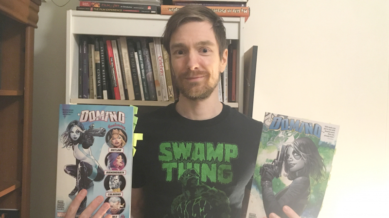 English Assistant Professor Dr. Troy Bordun holding two graphic novels