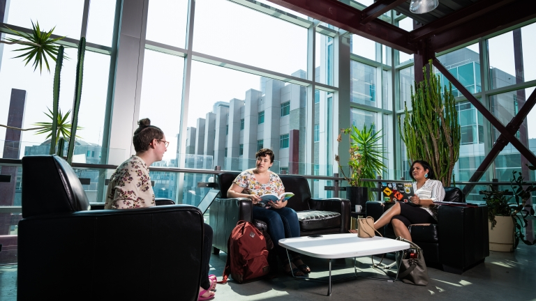 Students discussing in UNBC lounge area