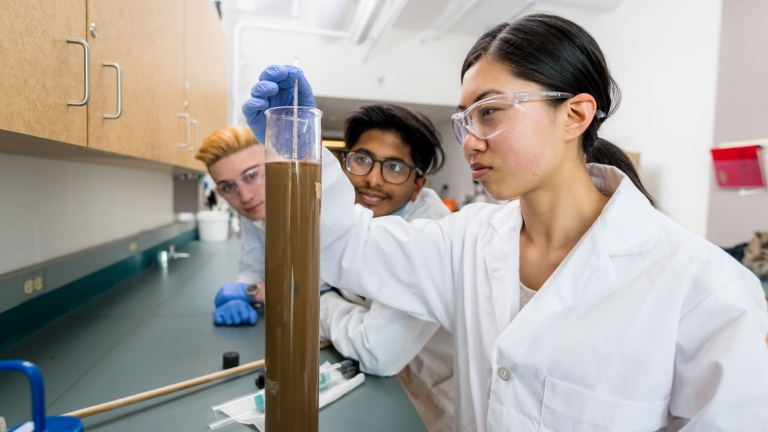 UNBC student experimenting in a science lab