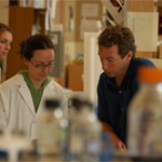 BCMB student Deb Curry (class of 2007) and Chemistry Professor Stephen Rader study RNA splicing in Dr. Rader's laboratory.