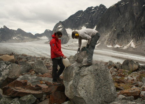 Dr. Brian Menounos working on a boulder
