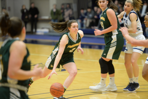 Madison Landry drives to the hoop.