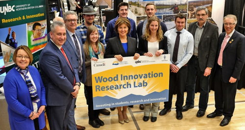 Group photo witth Wood Innovation Lab sign