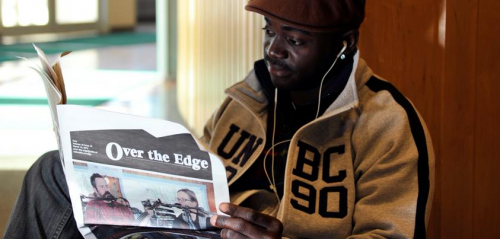 """Student reading """"Over the Edge"""""""