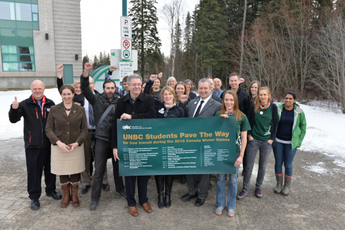 Students Pave the Way, along with representatives for partnering organizations and donors at the bus loop of UNBC.