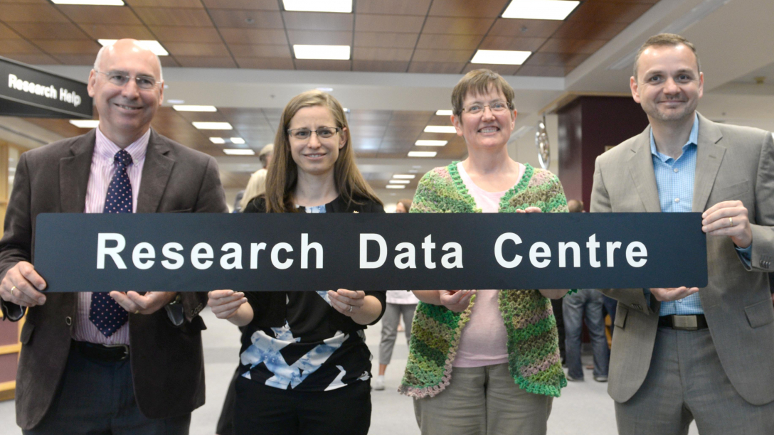 Dr. Paul Winwood, Dr. Lisa Oliver, Dr. Cindy Hardy and Dr. Geoff Payne celebrate the opening of the Research Data Centre