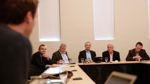 Senators listen to a question at UNBC event.